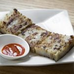 Pan-fried turnip cake at Tim Ho Wan dim sum restaurant in the East Village, on Jan. 13, 2017. (Samira Bouaou/Epoch Times)