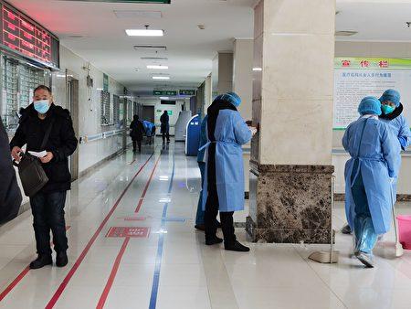湖北省武汉市是这次武汉肺炎的重灾区,一线医护在身心上都承受巨大压力。武汉一名女医生一晚曾接诊200名病人,甚至还要收尸。  (图片来源:Getty Images))